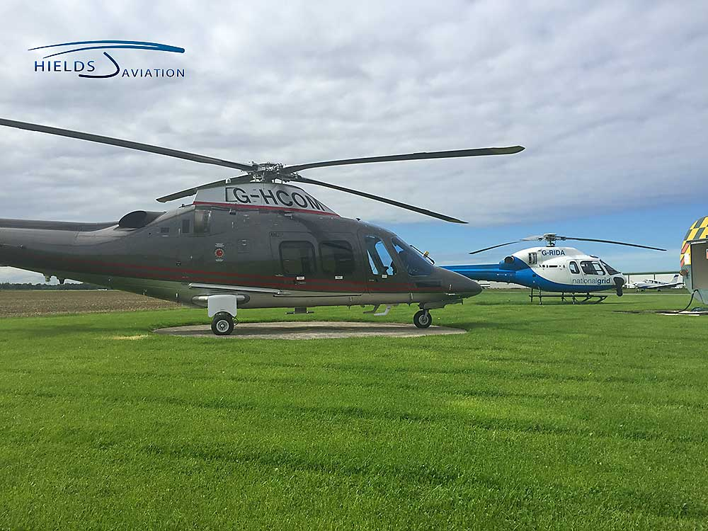 Brand new Agusta 109 resting alongside a Twin Squirrel at Sherburn airfield