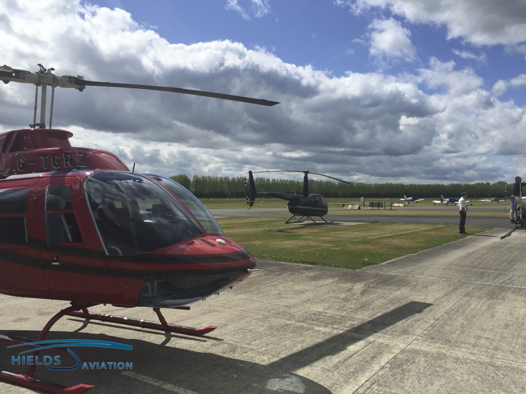 Our Robinson R44 beside Tiger's Bell 206 Jetranger at Shobdon